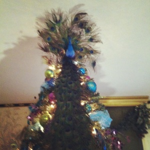 """A peacock in a Christmas tree..."""